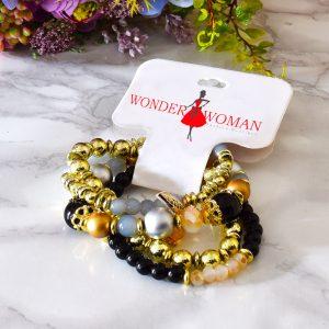 set štyroch elegantných čierno zlatých náramkov pre dámy